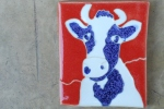 blue/white on red hill cow